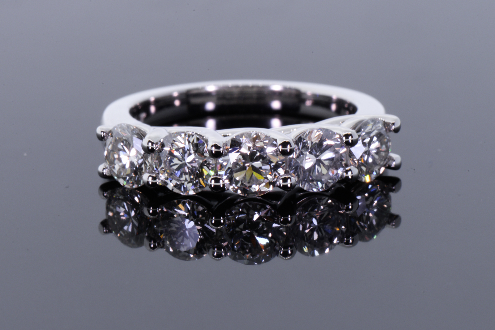 5 wedding band with cross prongs on the side this